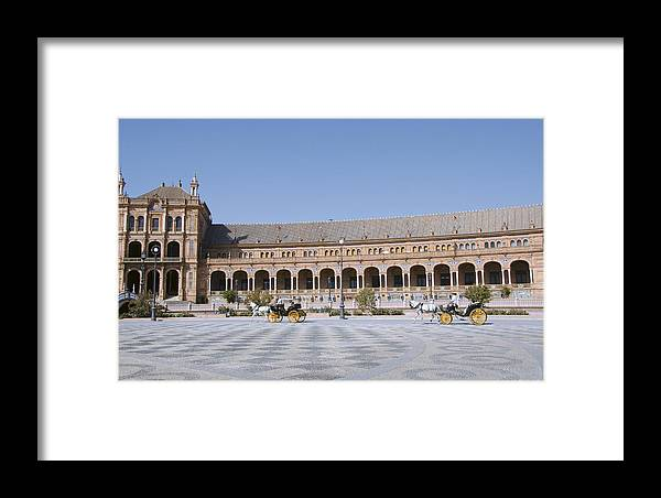 Arches Framed Print featuring the photograph Two Carriages In Front Of The Spanish Square by Perry Van Munster
