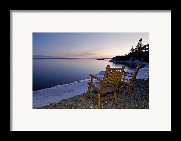 Sunset Framed Print featuring the photograph Two Chairs At Waters Edge Looking Out by Susan Dykstra