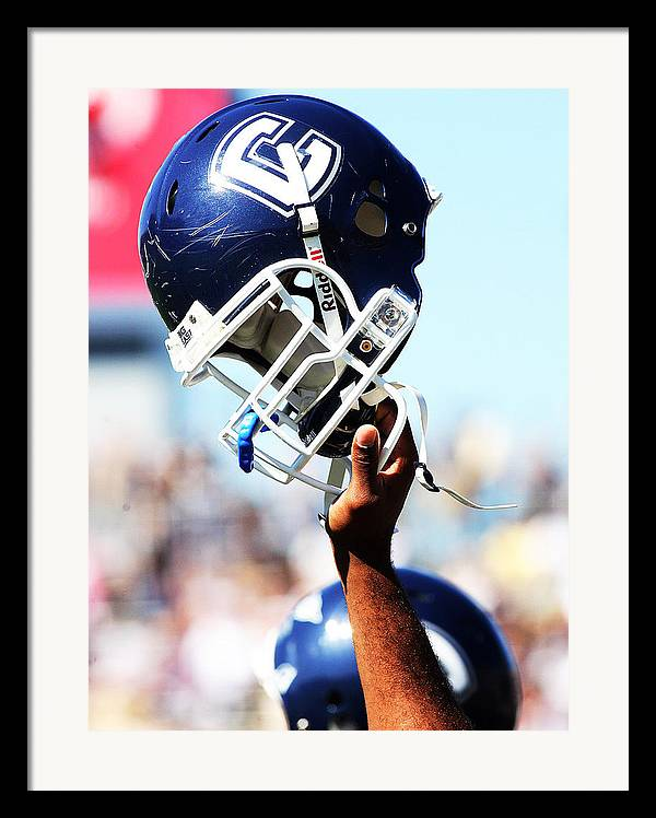 Replay Photos Framed Print featuring the photograph Uconn Helmet by University of Connecticut