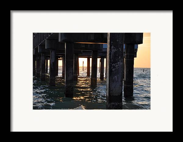 Under The Pier Framed Print featuring the photograph Under The Pier by Bill Cannon