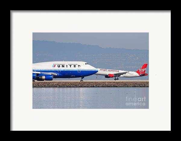 Virgin Framed Print featuring the photograph United Airlines And Virgin America Airlines Jet Airplanes At San Francisco International Airport Sfo by Wingsdomain Art and Photography