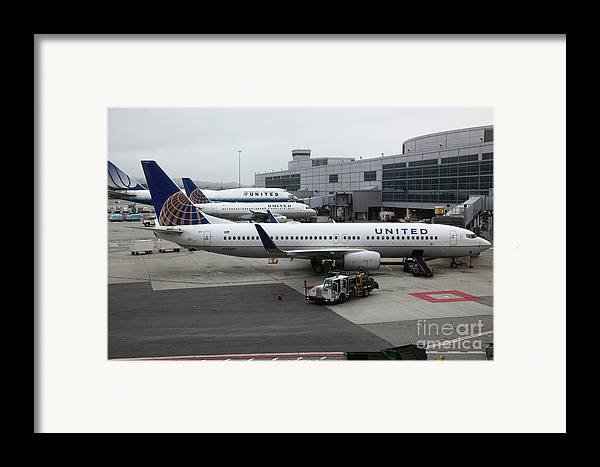 United Framed Print featuring the photograph United Airlines At Foggy Sfo International Airport . 5d16937 by Wingsdomain Art and Photography