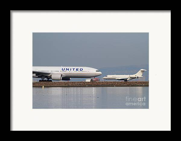 United Framed Print featuring the photograph United Airlines Jet Airplane At San Francisco International Airport Sfo . 7d12081 by Wingsdomain Art and Photography