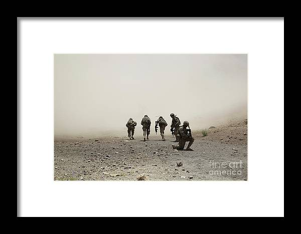 Dust Framed Print featuring the photograph U.s. Army Captain Provides Security by Stocktrek Images