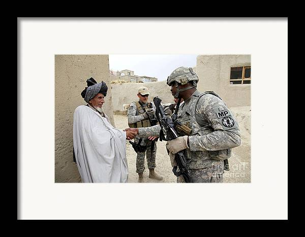 Middle East Framed Print featuring the photograph U.s. Army Soldier Shakes Hands With An by Stocktrek Images