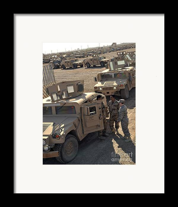 M1114 Framed Print featuring the photograph U.s. Army Soldier Speaks With Iraqi by Stocktrek Images