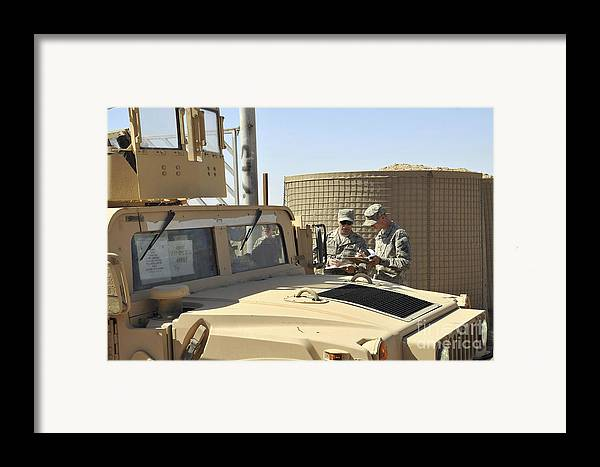 Helping Framed Print featuring the photograph U.s. Army Soldiers Take Accountability by Stocktrek Images