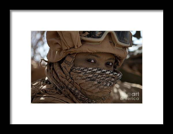 Marine Framed Print featuring the photograph U.s. Marine Covered In Dirt by Stocktrek Images