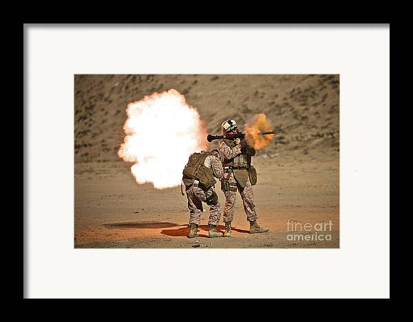 Operation Enduring Freedom Framed Print featuring the photograph U.s. Marine Fires A Rpg-7 Grenade by Terry Moore