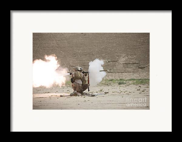 Desert Framed Print featuring the photograph U.s. Marines Fire A Rpg-7 Grenade by Terry Moore