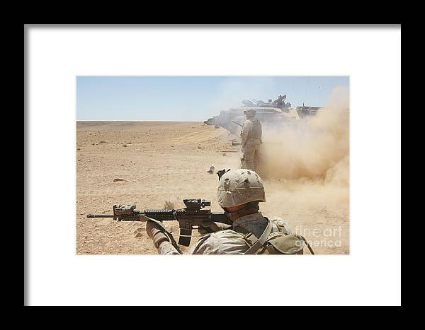Dust Framed Print featuring the photograph U.s. Marines Fire Several by Stocktrek Images