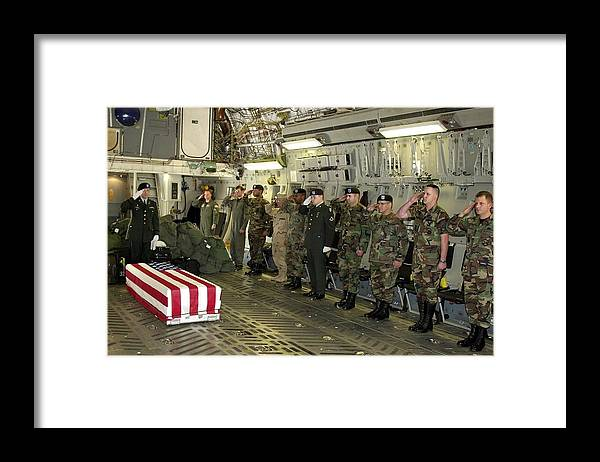 History Framed Print featuring the photograph U.s. Military Personnel Salute The Flag by Everett
