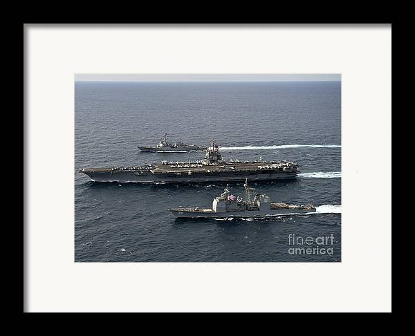 Atlantic Ocean Framed Print featuring the photograph U.s. Navy Ships Transit The Atlantic by Stocktrek Images