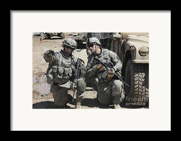 Military Framed Print featuring the photograph U.s. Soldiers Coordinate Security by Stocktrek Images