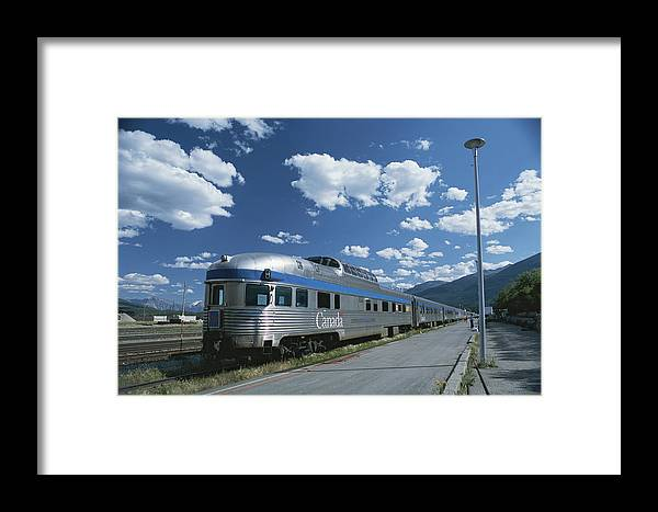 North America Framed Print featuring the photograph Via Rail Canada Train Waiting At Jasper by Todd Gipstein