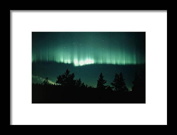 Aurora Borealis Display Framed Print featuring the photograph View Of An Aurora Borealis Display by Pekka Parviainen