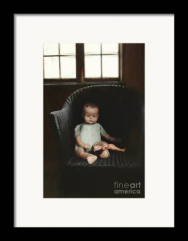 Atmosphere Framed Print featuring the photograph Vintage Dolls On Chair In Dark Room by Sandra Cunningham