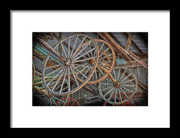 Wheels Framed Print featuring the photograph Wagon Wheels by Brian Mollenkopf