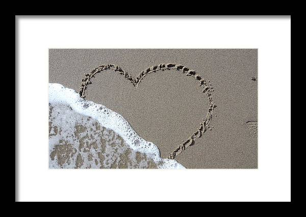 Heart Framed Print featuring the photograph Washed Away Love by Jessica Cruz