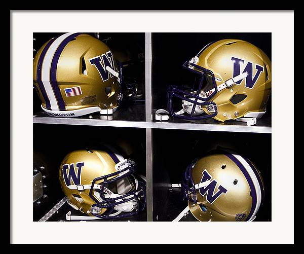 Replay Photos Framed Print featuring the photograph Washington Huskies Football Helmets by Replay Photos