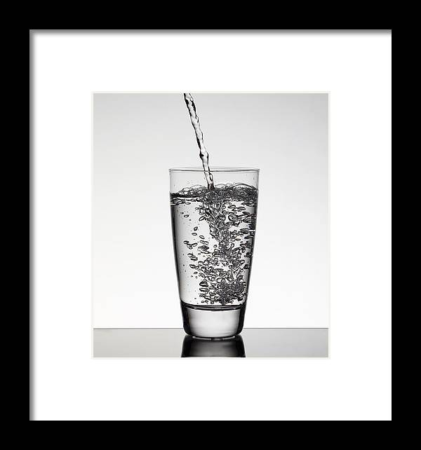 water pouring into glass framed print by walter zerla