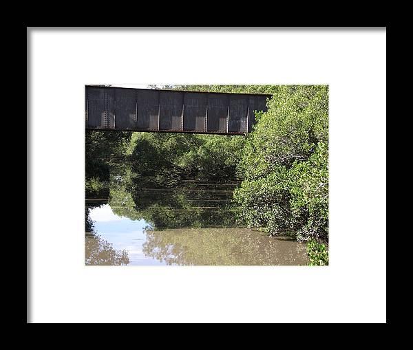 Train Bridge Framed Print featuring the photograph Water Under A Bridge by Rani De Leeuw