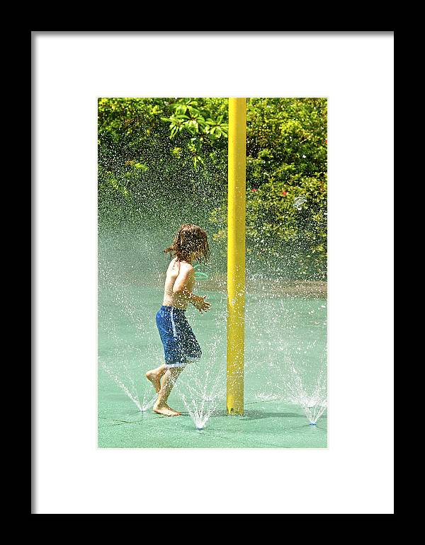 Boy Playing Framed Print featuring the photograph Watergames by Dieter Lesche