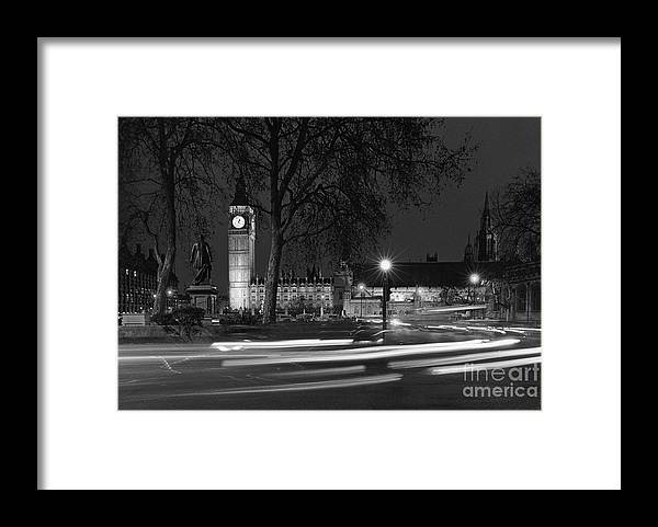 Westminster Palace Framed Print featuring the photograph Westminster Night Traffic by Aldo Cervato