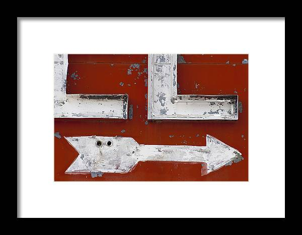 Route 66 Framed Print featuring the photograph White Arrow On Motel Sign by Carol Leigh