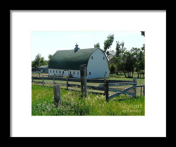 Fences Framed Print featuring the photograph white barn in ND by Bobbylee Farrier