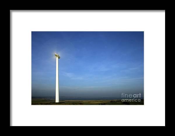 Energymaking Framed Print featuring the photograph Windturbin by Jorgen Norgaard