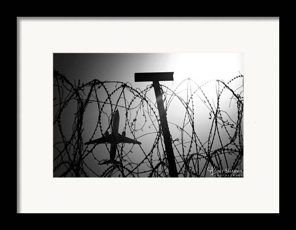 Airplane Framed Print featuring the photograph Wings by Aunit Sharma