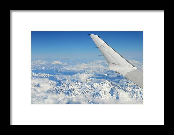 Freedom Framed Print featuring the photograph Wings Of Flying Airplane Over French Alps by Sami Sarkis