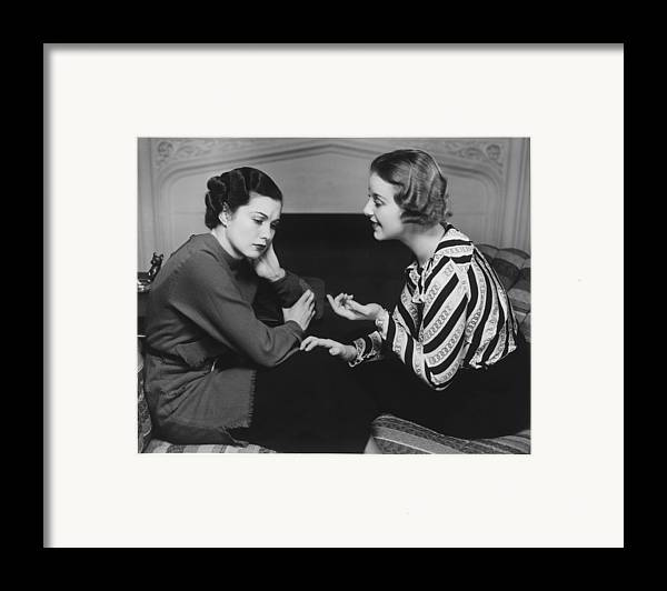 25-29 Years Framed Print featuring the photograph Woman Consoling Friend At Fireplace, (b&w) by George Marks