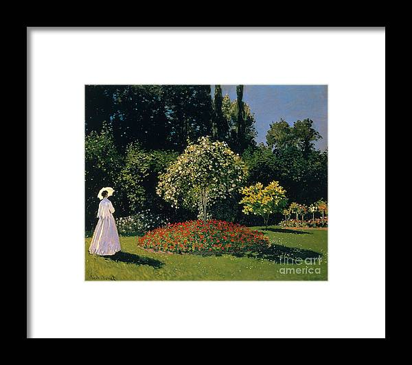 Claude Monet Framed Print featuring the painting Woman In A Garden by Extrospection Art