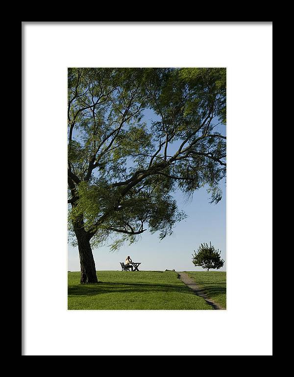 One Person Framed Print featuring the photograph Woman Sitting At Picnic Bench by Todd Gipstein