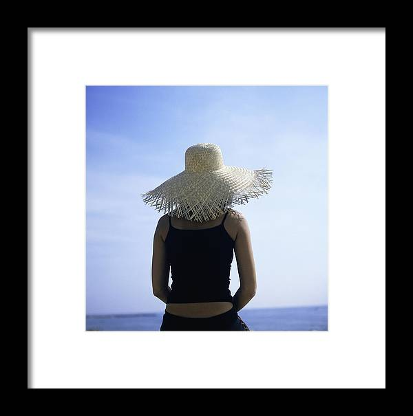 Woman Framed Print featuring the photograph Woman Sunbathing by Cristina Pedrazzini