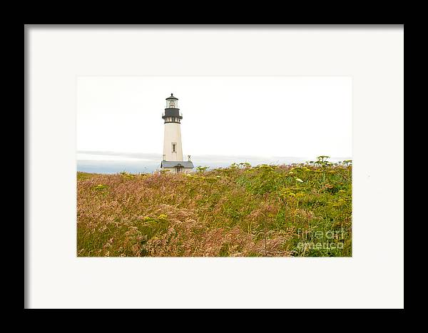 Yaquina Head Lighthouse In Oregon Framed Print featuring the photograph Yaquina Head Lighthouse In Oregon by Artist and Photographer Laura Wrede