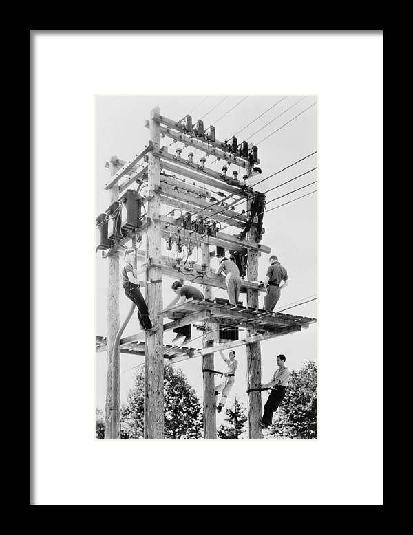History Framed Print featuring the photograph Young Men Working On Telephone Poles by Everett