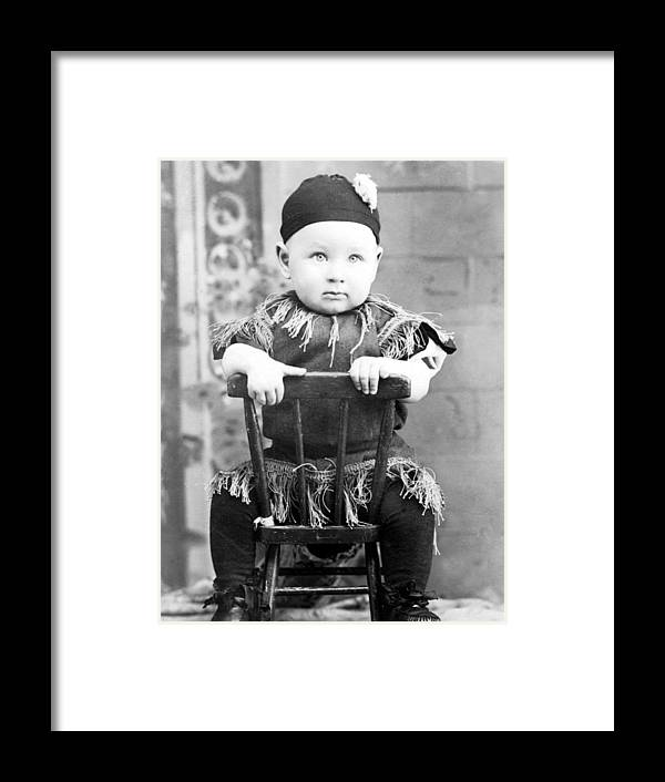 Boy Framed Print featuring the photograph Boy Dressed Elf Sitting Backwards In Chair 1890s by Mark Goebel