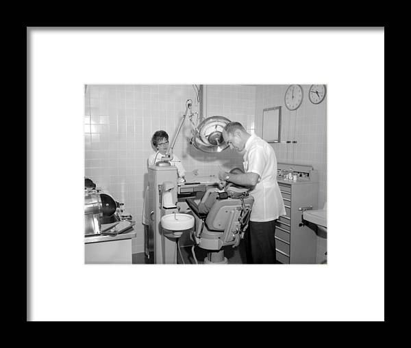 Dentist Framed Print featuring the photograph Dentist Working Patient October 18 1962 Black by Mark Goebel
