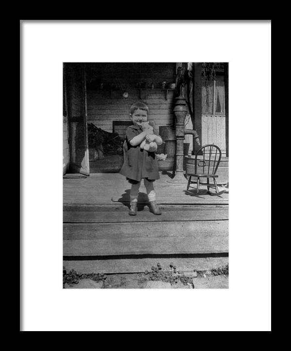 Girl Framed Print featuring the photograph Girl Hugging Stuffed Animal Porch 1920s Black by Mark Goebel