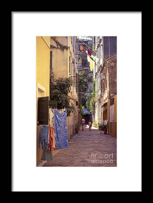 Corfu Framed Print featuring the photograph Greece. Venetian Street In Corfu Old Town. by Steve Outram