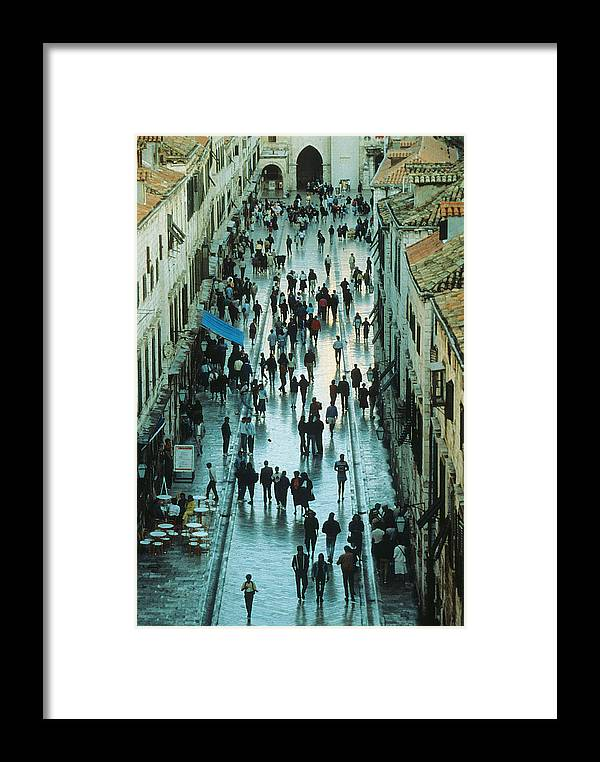 Ancient Framed Print featuring the photograph Promenade In Dubrovnik by Carl Purcell