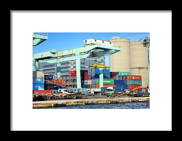 Taiwan Framed Print featuring the photograph A Container Is Loaded In Kaohsiung Port by Yali Shi