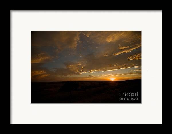 Badlands National Park Framed Print featuring the photograph Badlands Sunset by Chris Brewington Photography LLC