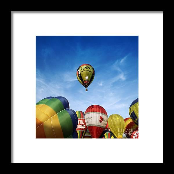 Balloon Fiesta Framed Print featuring the photograph Balloons by Angel Ciesniarska