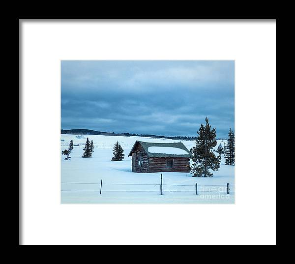 Cabin Framed Print featuring the photograph Cabin In The Snow by Carolyn Fox