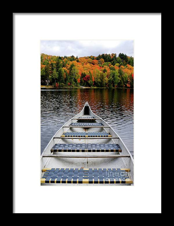 Canoe Framed Print featuring the photograph Canoe On A Lake by Maxim Images Prints