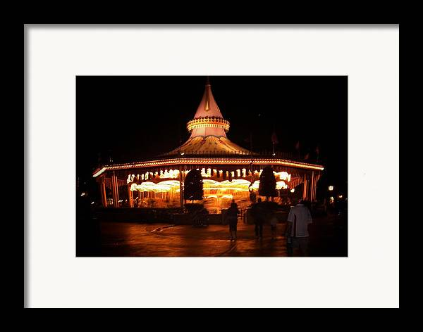 Carousel Framed Print featuring the photograph Carousel by Lindsay Clark